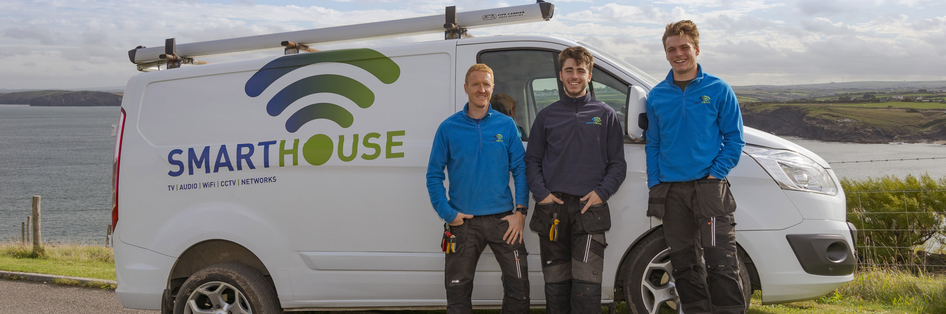 Smarthouse Staff stand beside Work Van